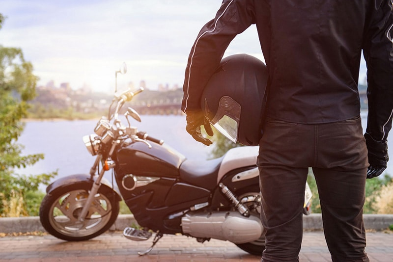 Motorcycle Insurance: How to Choose the Best Coverage a person with a motrocycle