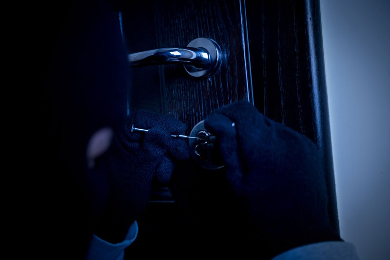 Protect Your Apartment From Burglary burglar picking a lock