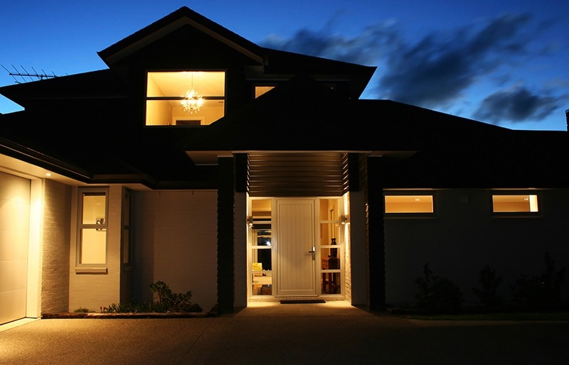 Top Ways to Improve Home Safety on a Budget exterior of house with lights on