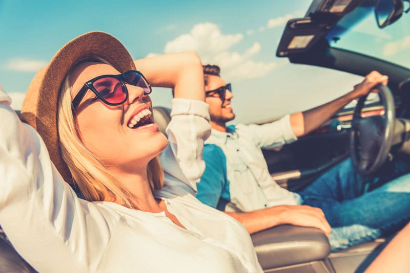 Smart Snacking Tips for Your Summer Road Trip two people driving on a road trip