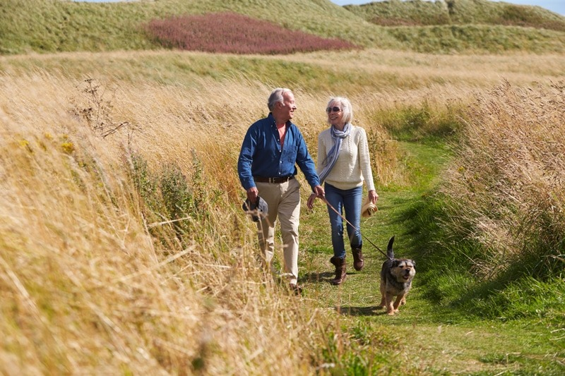 seniors walking a dog The Best Life Insurance Policies for Seniors