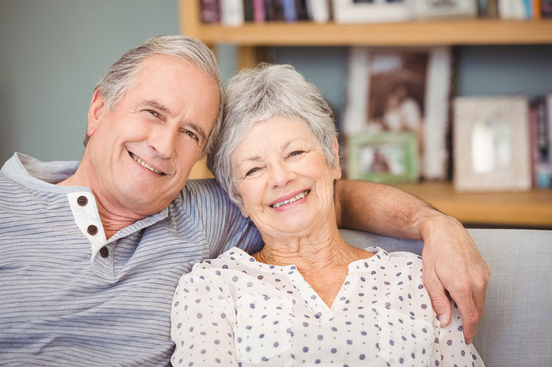 seniors smiling Why You May Need Life Insurance After Retirement