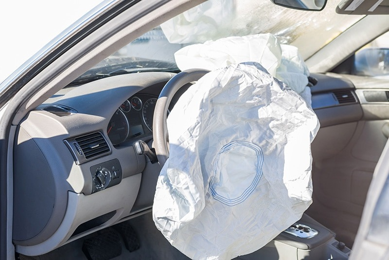 a deflated air bag in a car