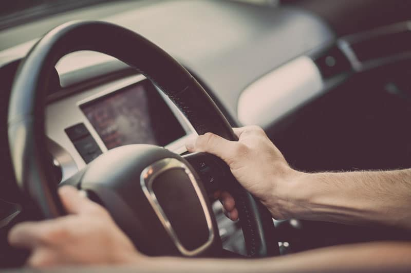 a steering wheel of a car being driven