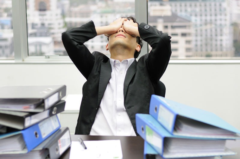 a man at work stressed