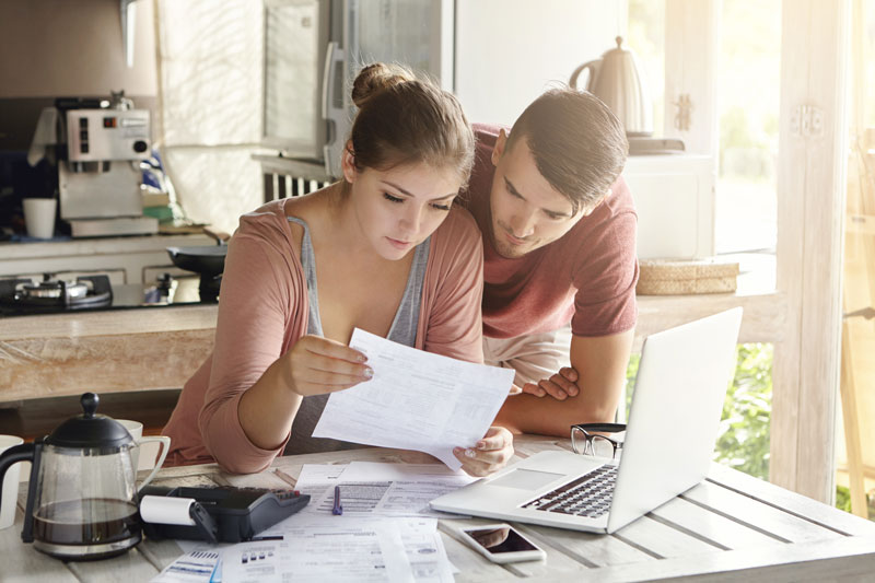two people reviewing paper