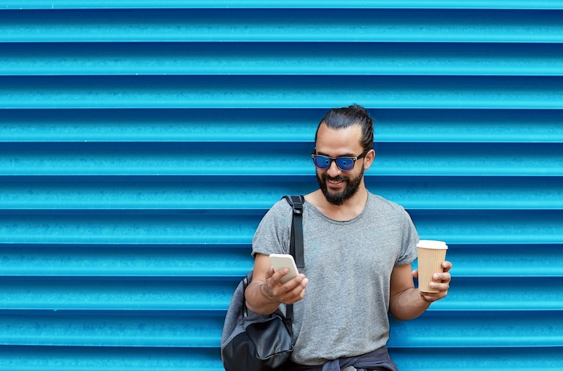 a man holding a coffee cup